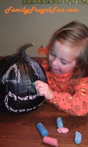 Writing on a pumpkin with chalk image