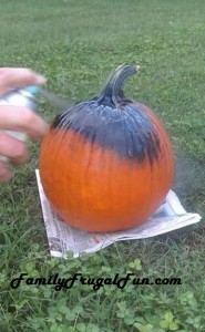 pumpkin being spray painted black with chalk board paint image